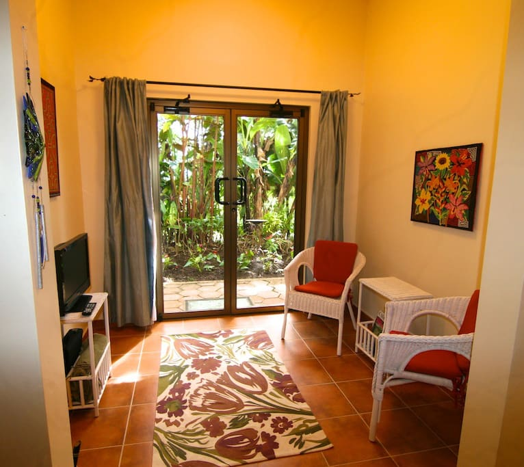 Sitting area of the Garden Suite. French doors open onto garden.