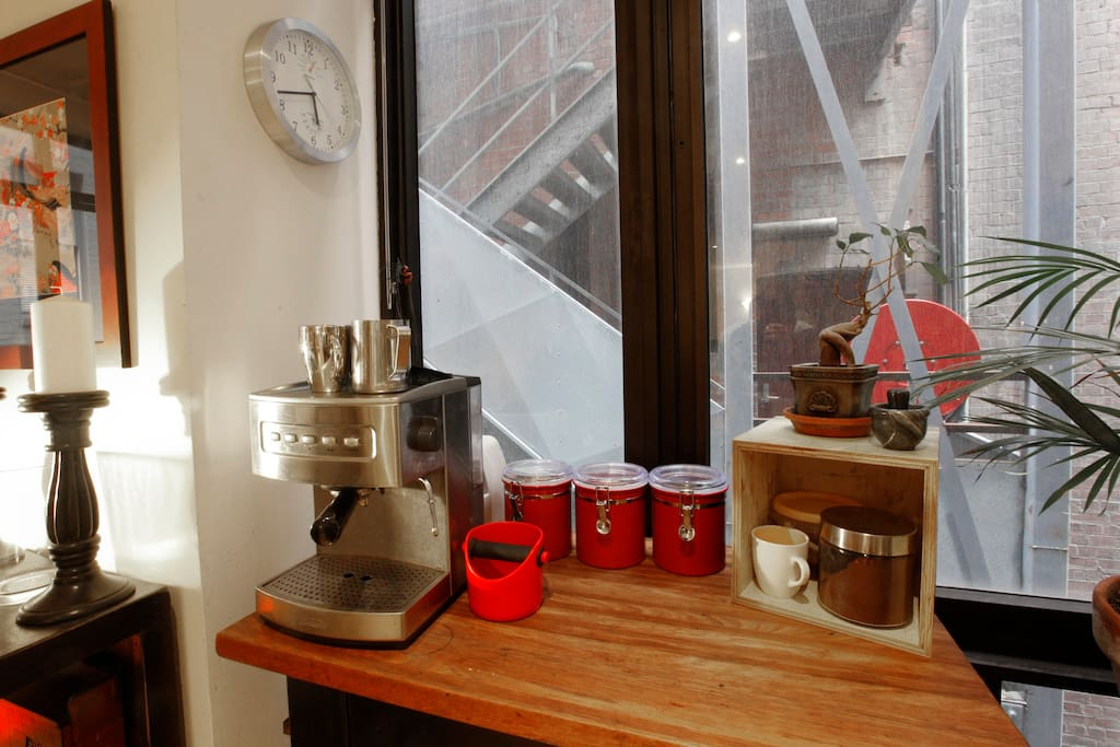 Very important - an espresso machine that makes amazing coffees (or go next door!)
