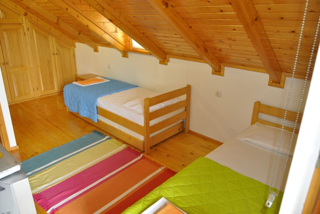2nd bedroom with 2 main and 2 additional beds under them.