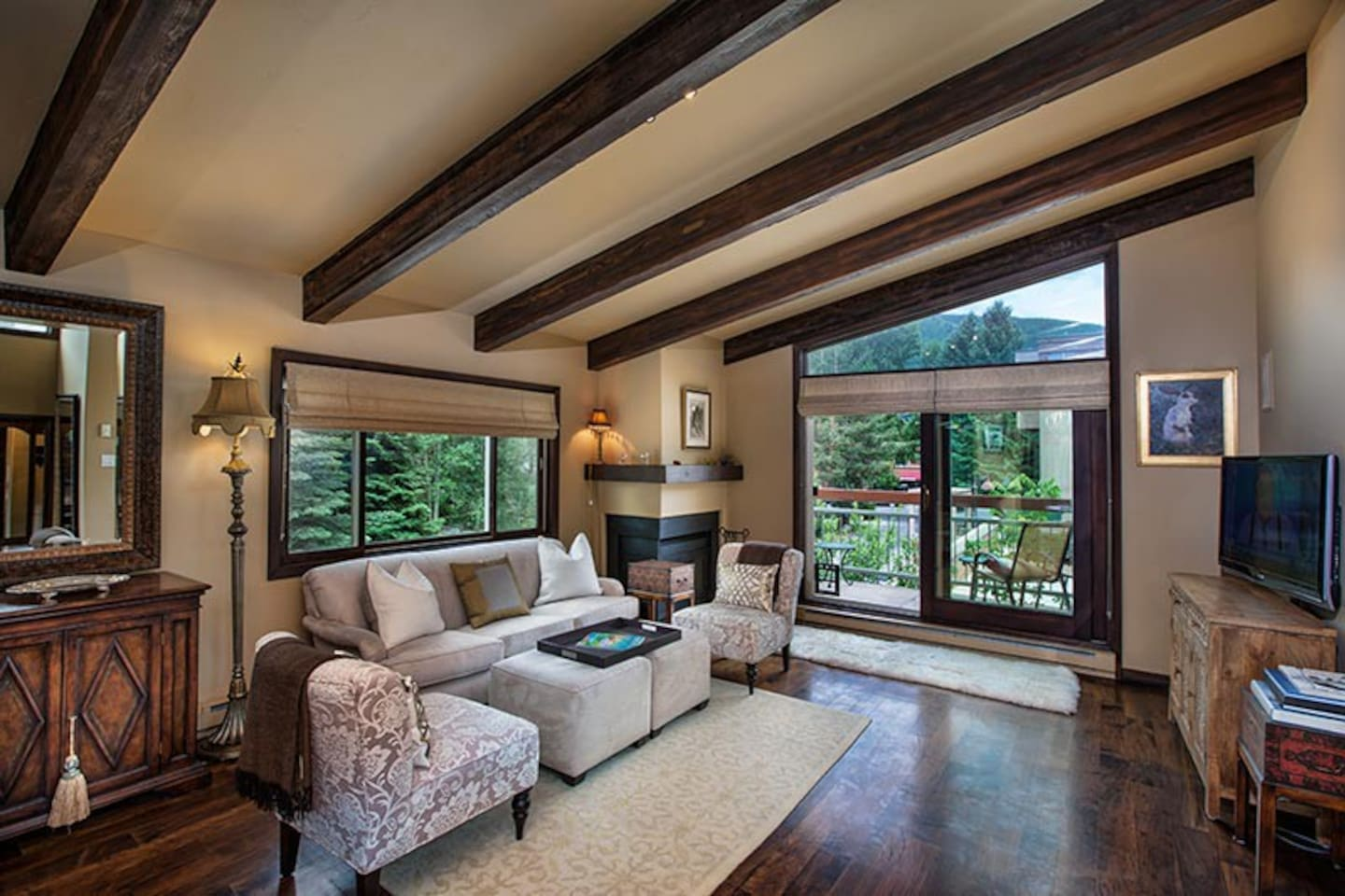 Living room with vaulted ceilings. Lots of natural light