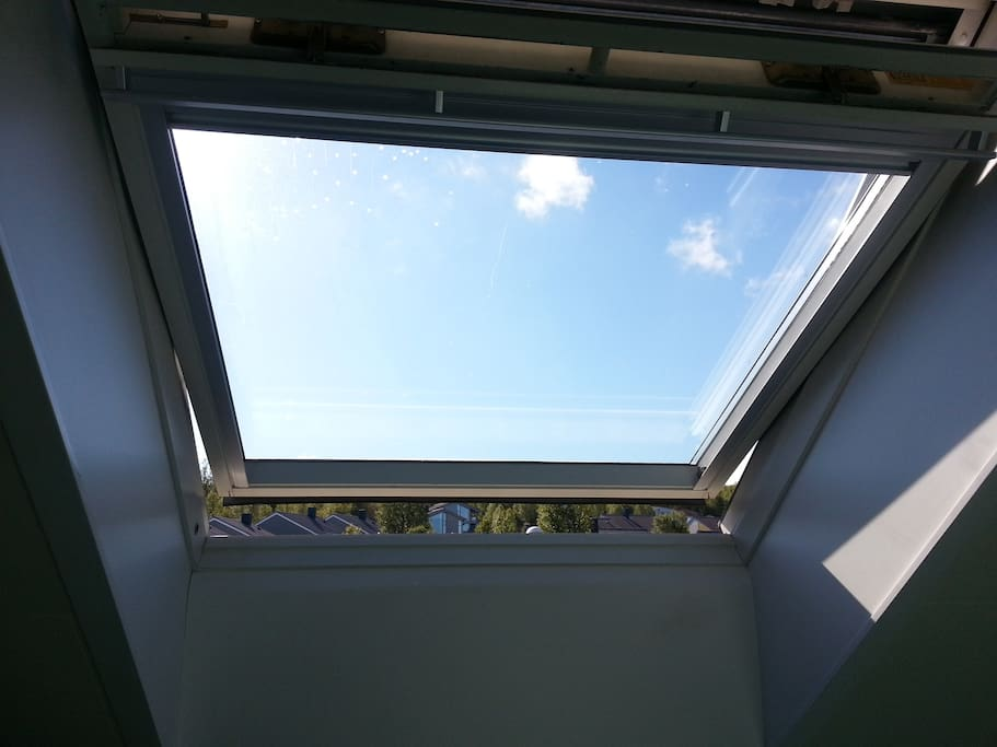 In summertime, the roof window takes the blue sky into the room.