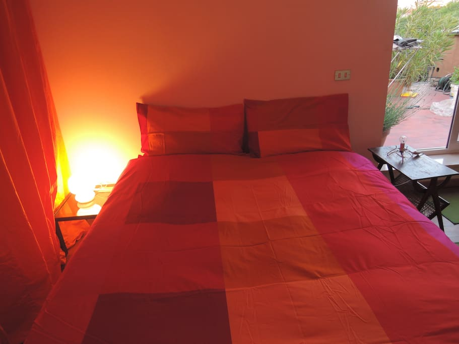 orange room 's bed in the evening