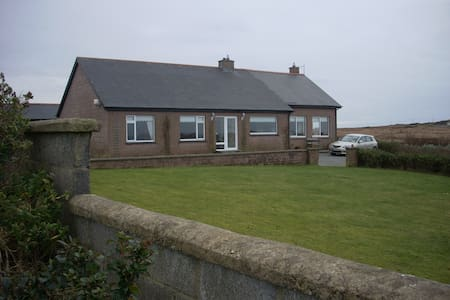 Lovely house with great views out to the islands of Inis bofin and shark.  Great area for beach walking and swimming in clean water. Cycling or mountain climbing.  Close to the lovely fishing village of cleggan and beach on omey island.  20 mins drive to  Kylemore  Abbey/ Notredame university.