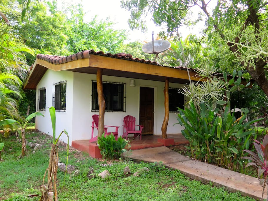 Cabina surrounded by tropical garden