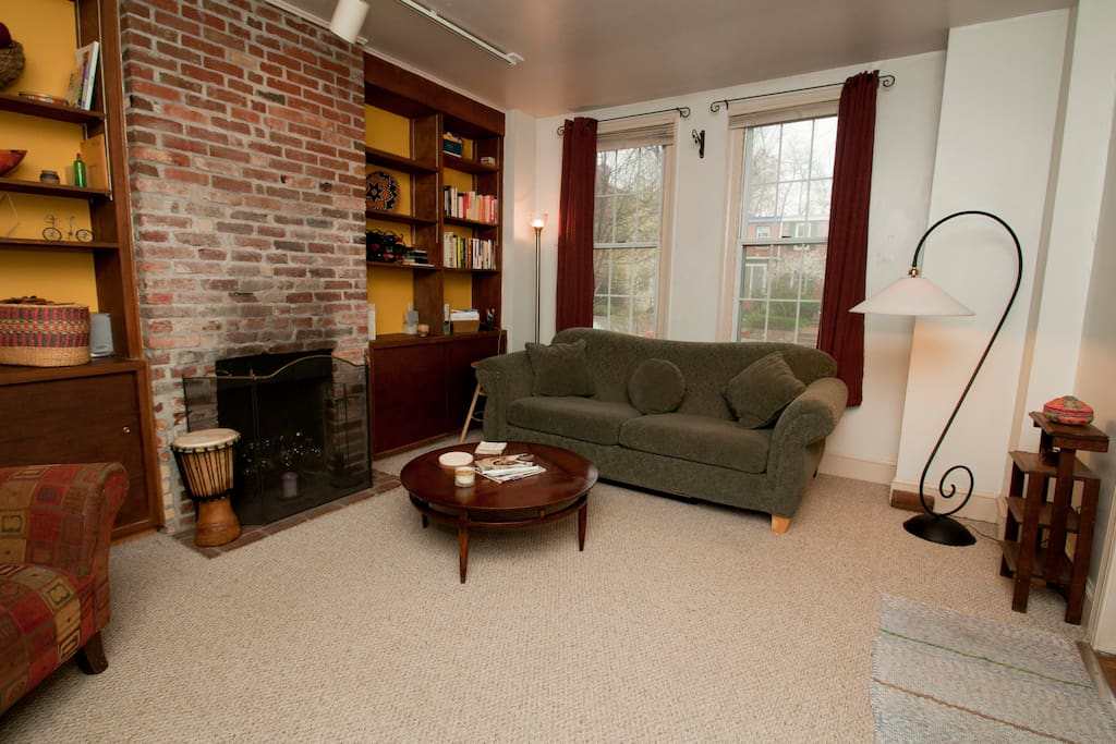 Spacious living room looks out onto quiet residential street in famed Eastern Market neighborhood.