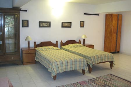 Very quiet and private with a small sit-out area under a coconut tree. Comfortable furniture including a TV and a tiny kitchenette. Swimming pool available inside complex. Walking distance to beach (800 meters) and to eateries on the main road.