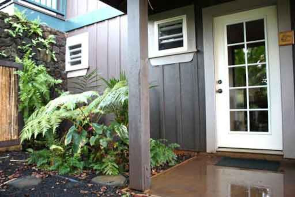 Your private entrance located in a lush tropical garden.