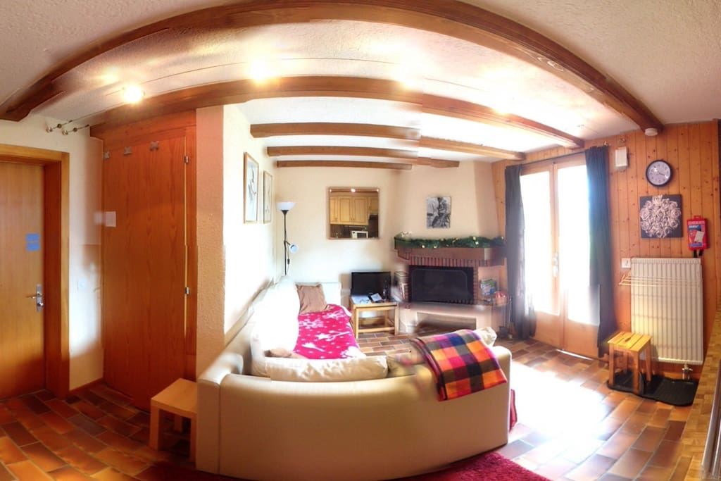Living room and kitchen. Please note this photo is taken using a 360 app so that we could show the whole room.