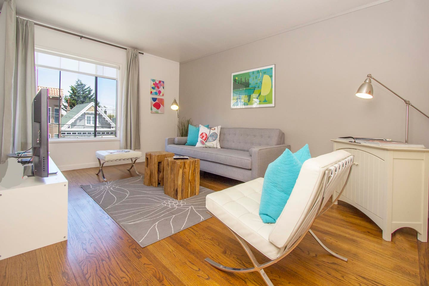 Spacious, comfortable living area with hardwood floors and tons of natural light.