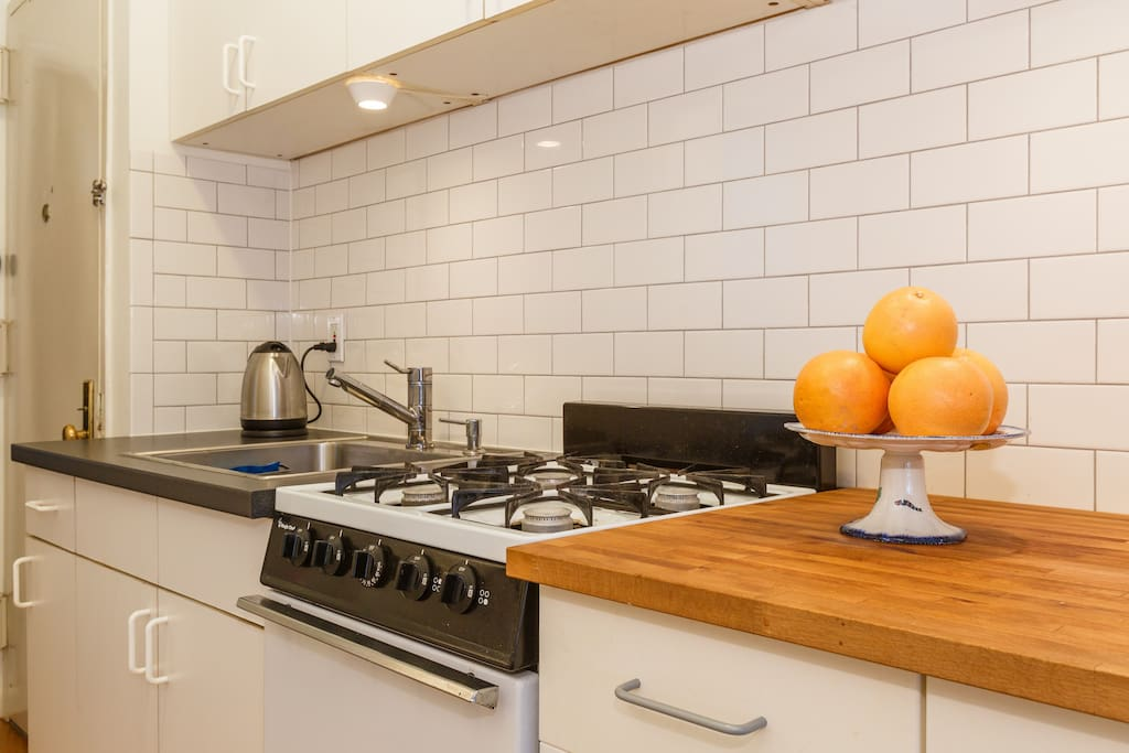 Gourmet kitchen with all the pots, pans, and utensils needed to prepare yourself breakfast, snacks or meals in the apartment.