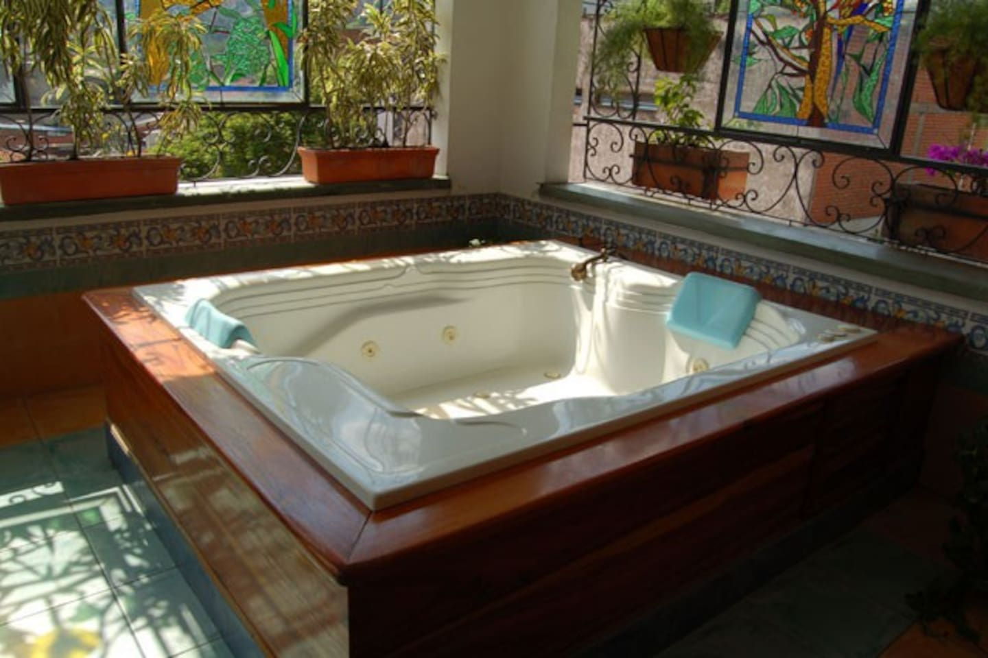 jacuzzi with city view...open air surrounded by beautiful plants