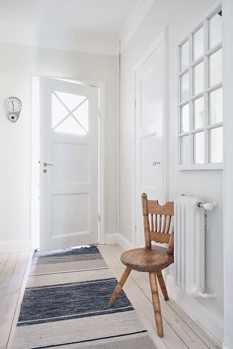 Hallway with the bathroom to your right