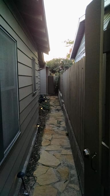 Pathway along house, is natural stone so a bit bumpy and watch your step. Lighted at night.