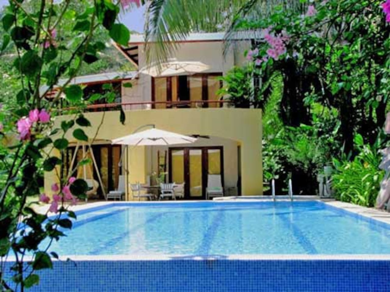 The huge infinity pool & jacuzzi are steps from the beach.