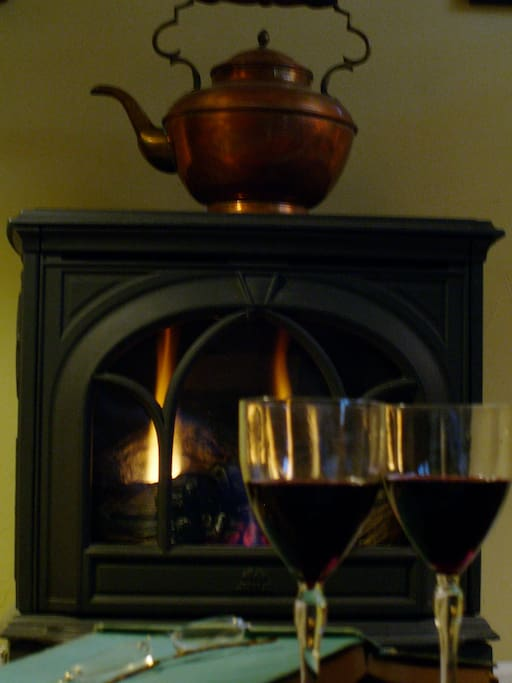 Enjoy a glass of wine in front of the warmth of the gas fireplace.
