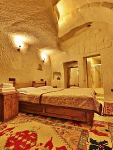 Elysee Hotel is centrally located in the village of Göreme, in a restored farmhouse carved into the ancient rock and local tufa stone.