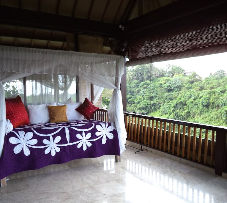 Recline on your day bed on your private balcony, bounty of nature all around