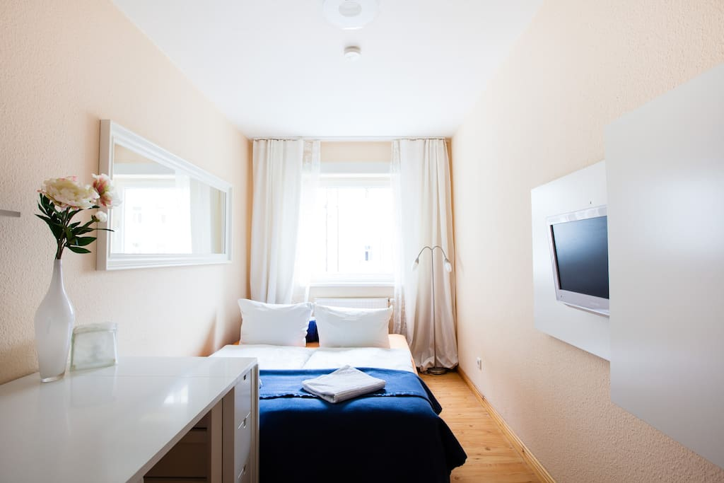 Small room with 2 single beds, moved together as a double.