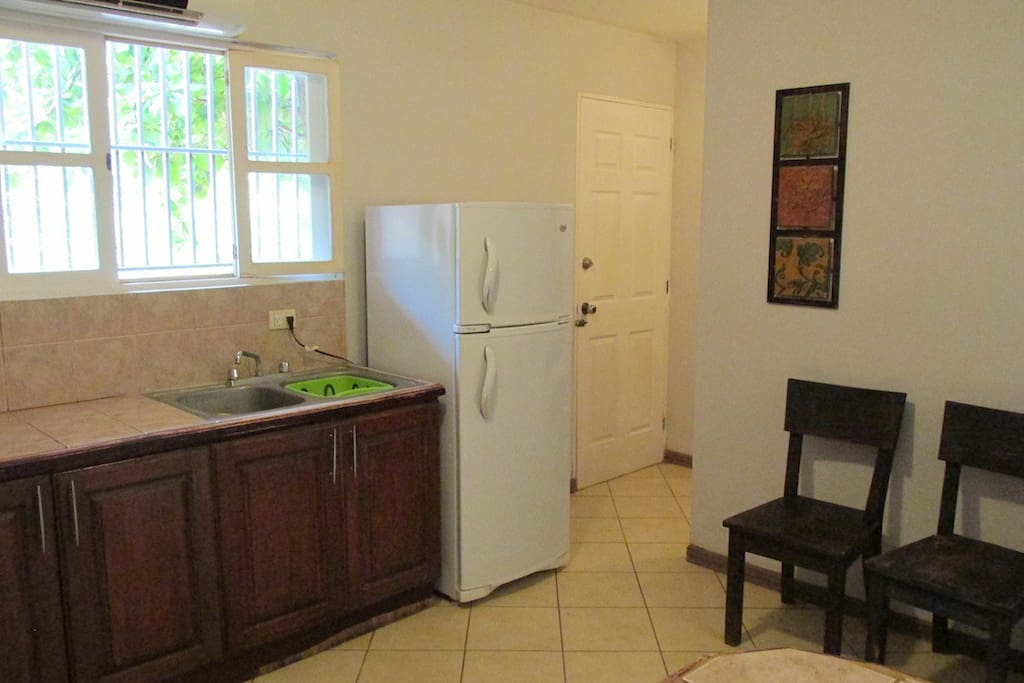 Kitchen and acces to back patio and laundry.