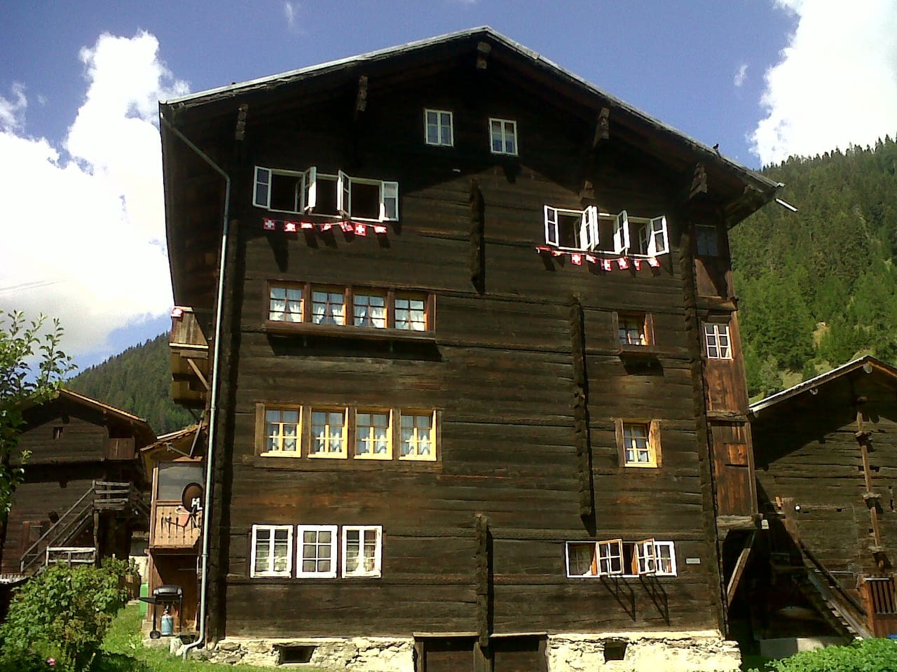 Enjoy the most typical unique Swiss Chalet! The 3rd floor (with swiss flags) its balcony and the 2 rooms above are all yours!