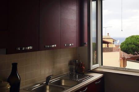 Appartamento con vista sul mare - Lejlighed
