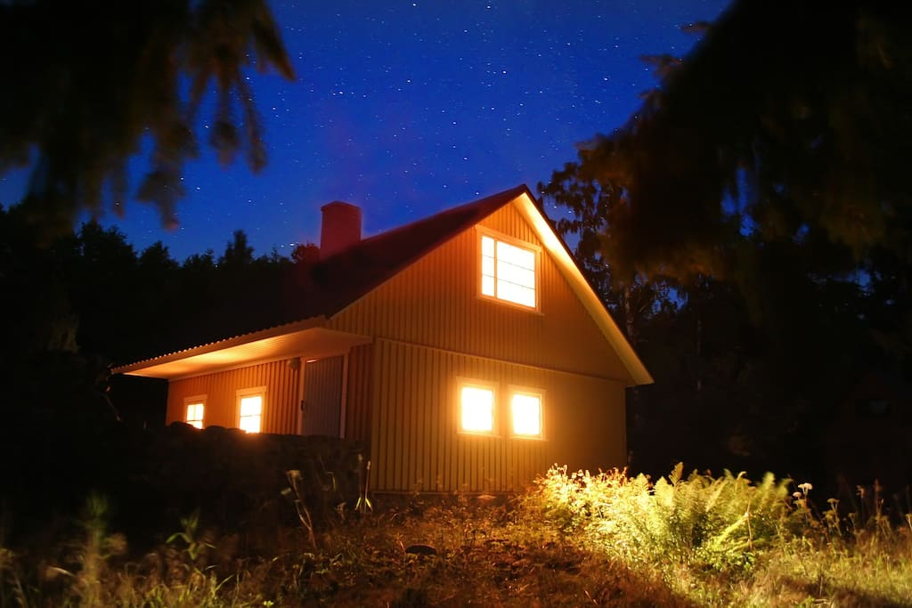 The smaller house at night.