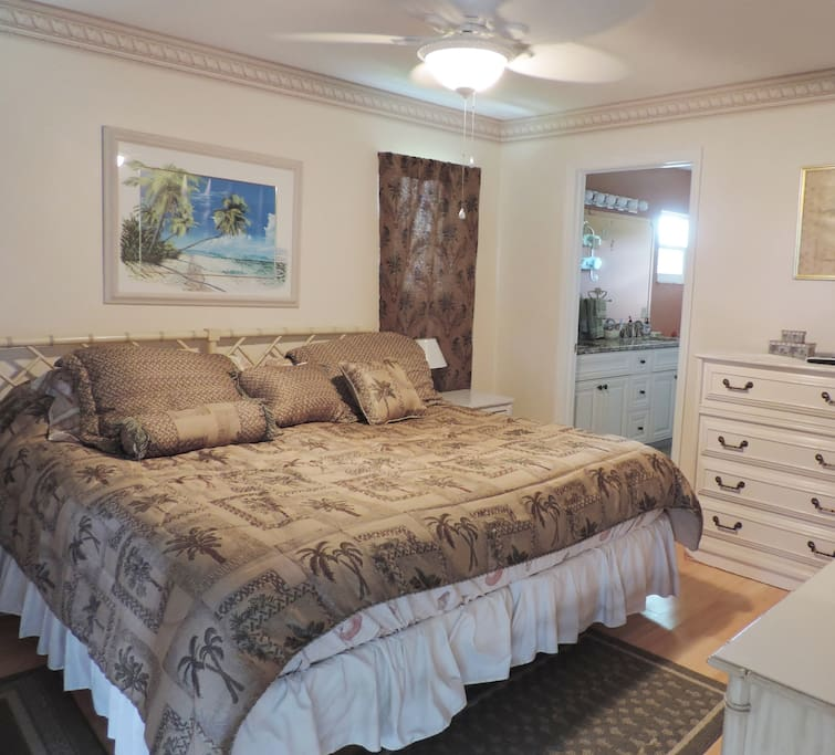 Master bedroom with pillow top king-size bed.
