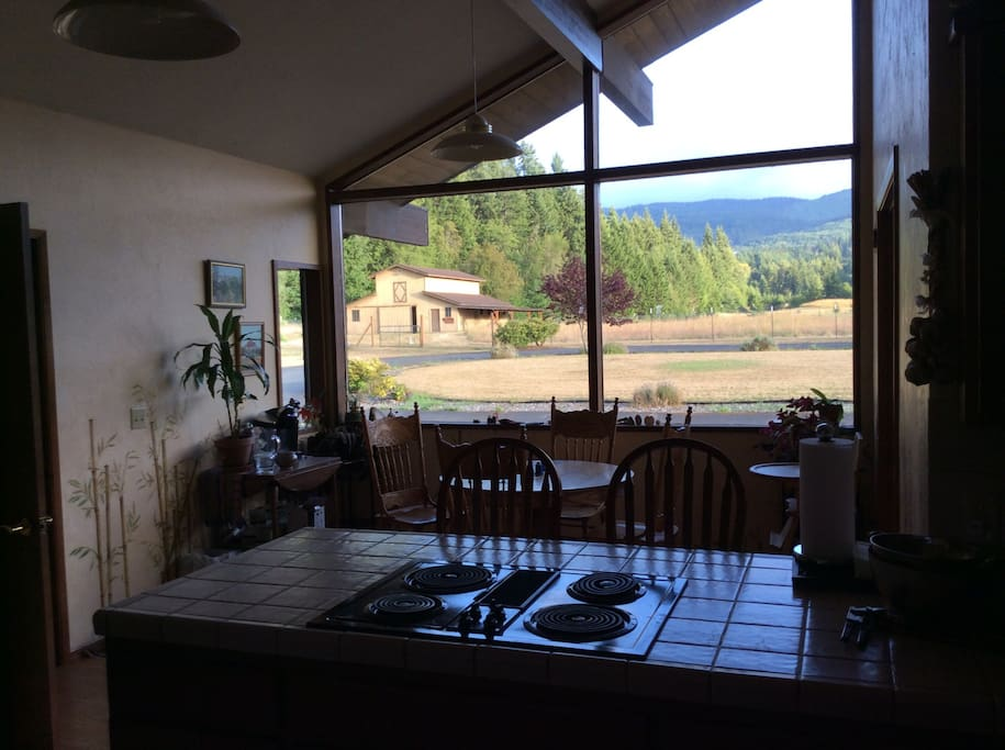 Comfy kitchen with mountain views and eating space.  There is a separate, more private dining room off the kitchen.