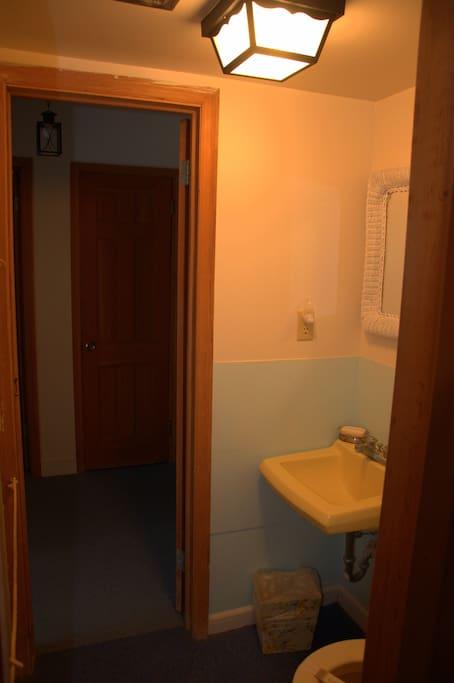 Downstairs yellow room half bath