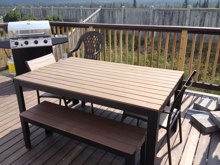 Deck, patio furniture and BBQ.