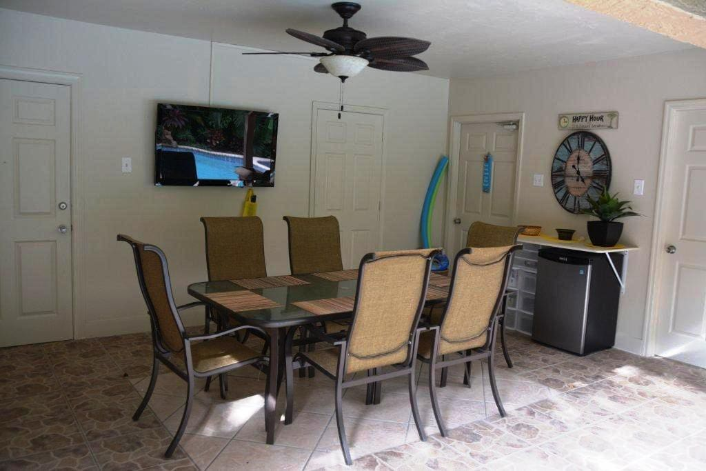 Lanai with flat screen TV...the TV reflects a perfect picture even when it's off! Enjoy the convenience of simple food preparation right on the lanai, which has a mini-fridge and granite counter.