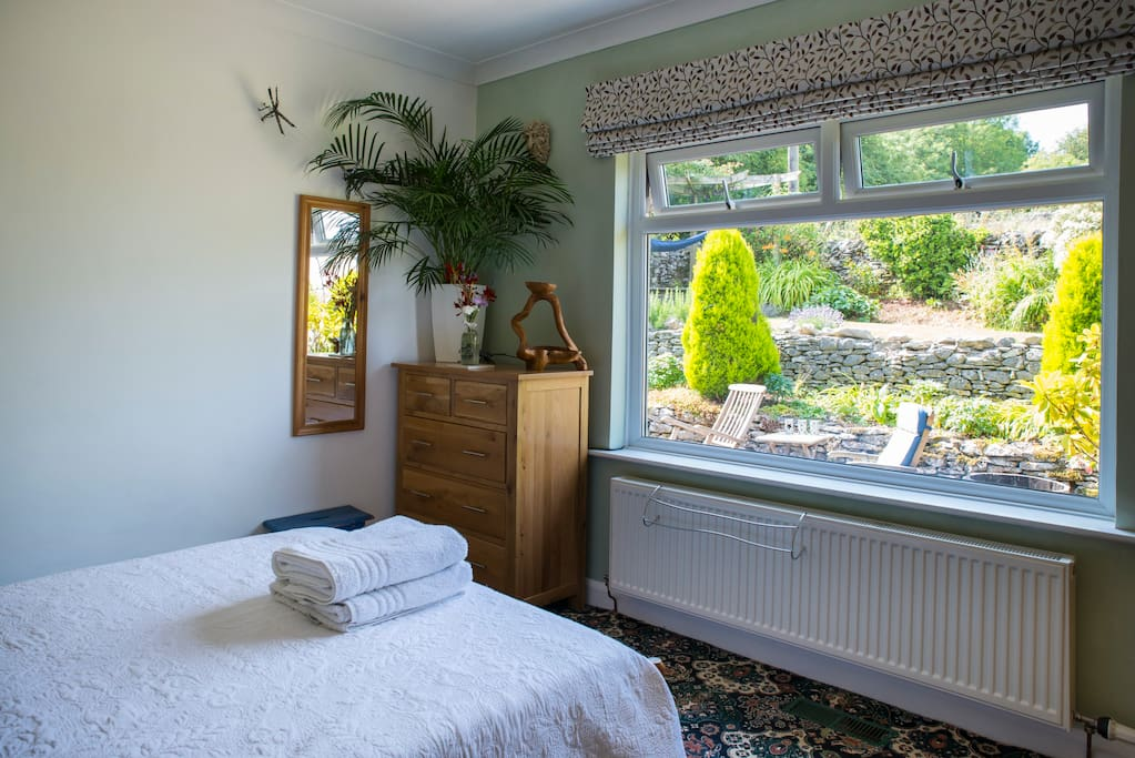 Guest bedroom looking onto rear garden and The fields at the foot of Cunswick Fell.