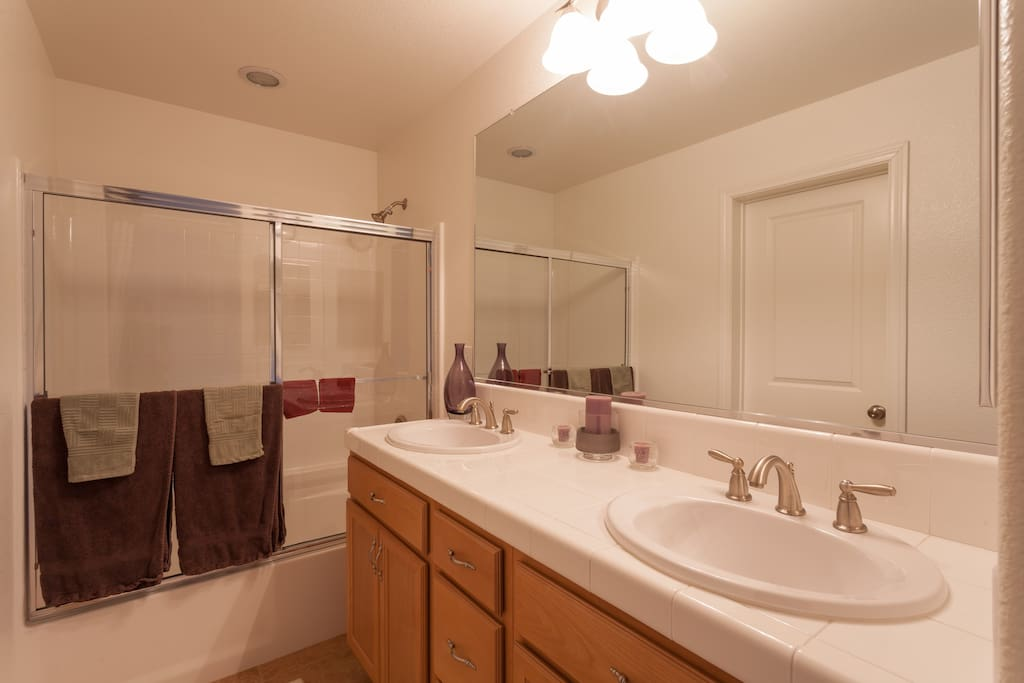 Double sinks and plenty of counter space in the bathroom.
