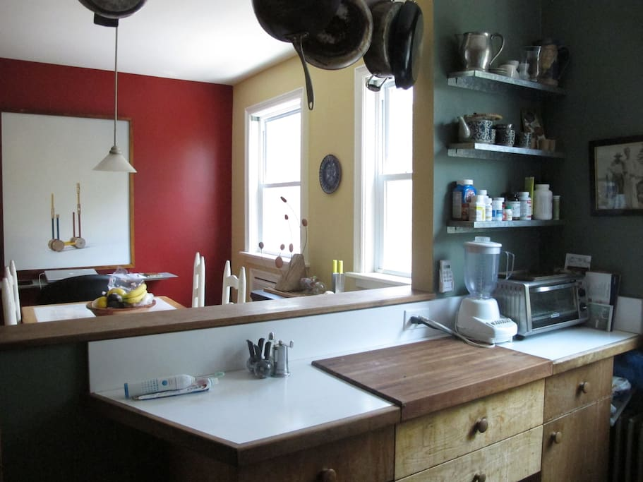 Well-equipped kitchen passes through to dining table.