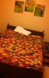 Cozy room with a double bed. Good for one or two people. You will also have your own bathroom with shower. You are welcome to use the living room and open deck. WiFi available.