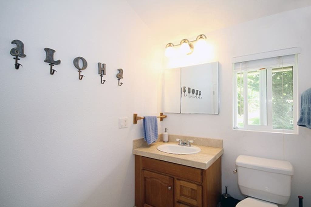 Large Bathroom with shower, one half bath, and an outdoor hot shower