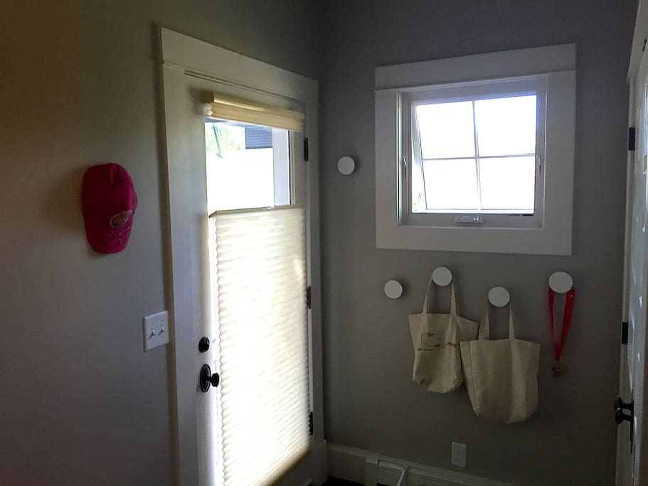 Inside side entrance:  wall dots for hanging, full laundry in closet to right of photo