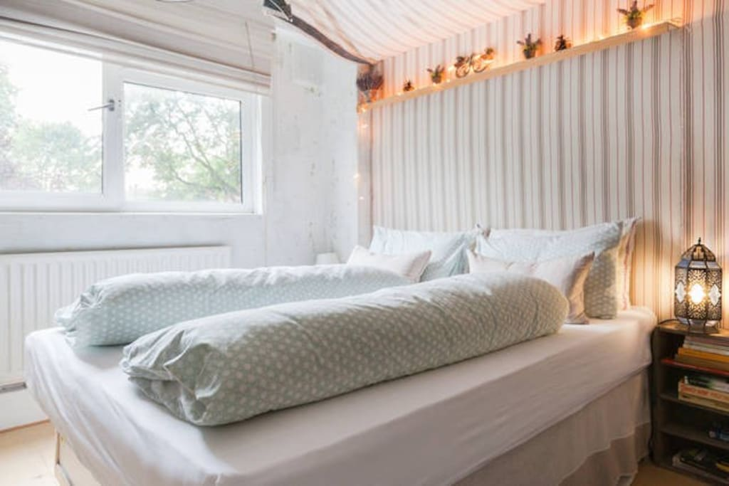 king size canopy arthopedic bed with choice of seperate duvets or one - with a selection of 350 threadcount designer sheets and towels - with views of park and private gardens