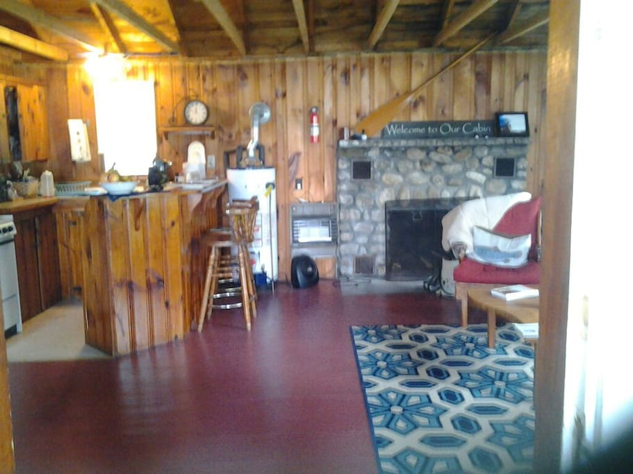 Full-Housekeeping Cottage. Open concept kitchen/living room. Appliances include coffee maker, grinder, microwave, full fridge.
