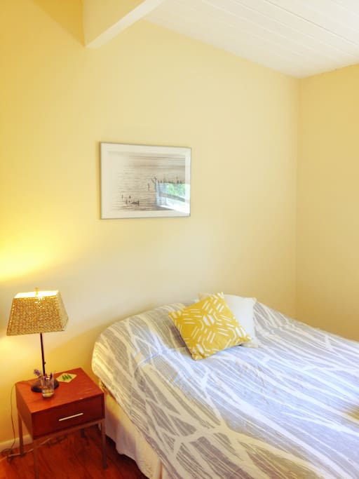Your light, bright, and airy private room. The cozy room is perfect for 1 or 2 travelers, and includes a full-sized bed.