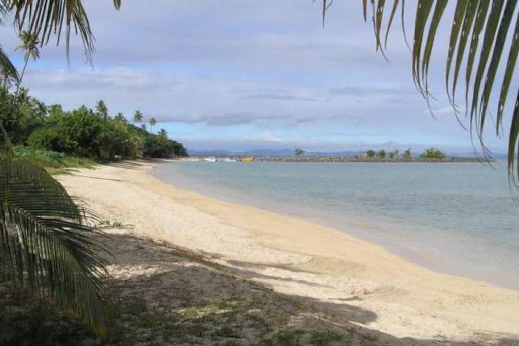 Stroll on this golden sandy beach to a neighbouring resort