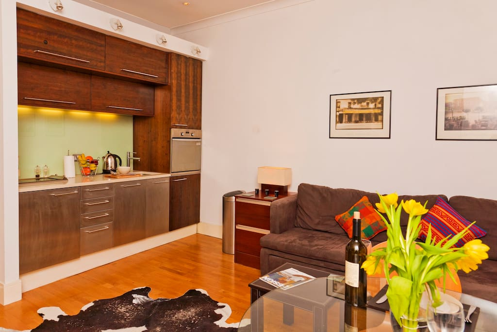 The main lounge/dining room with fully-fitted integrated kitchen has hardwood oak flooring throughout.