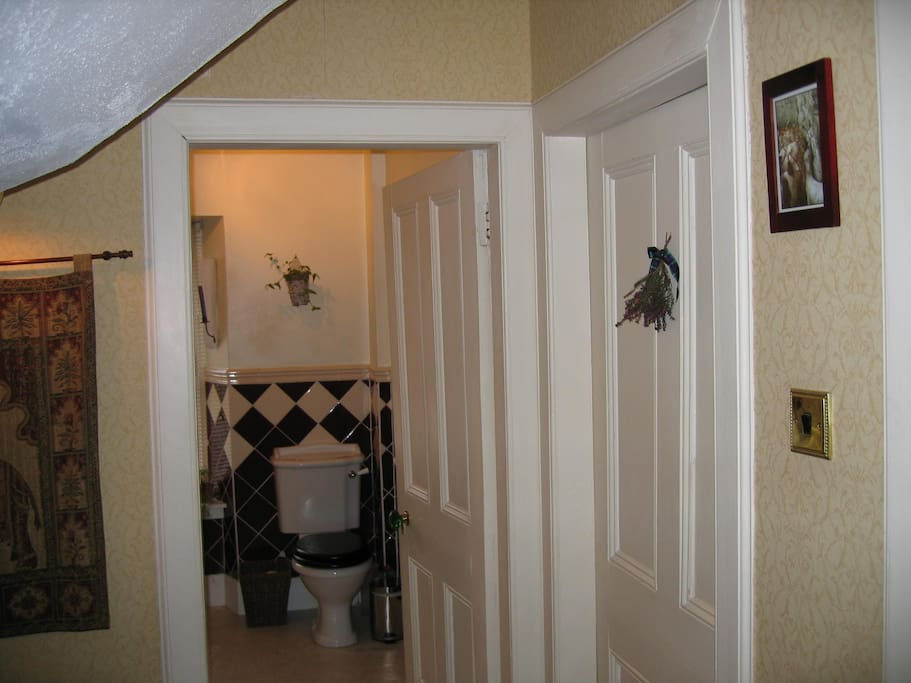 landing with the guest bedroom next to the bathroom