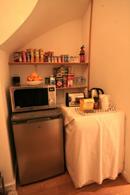 food prep area with fridge freezer oven grill and microwave
