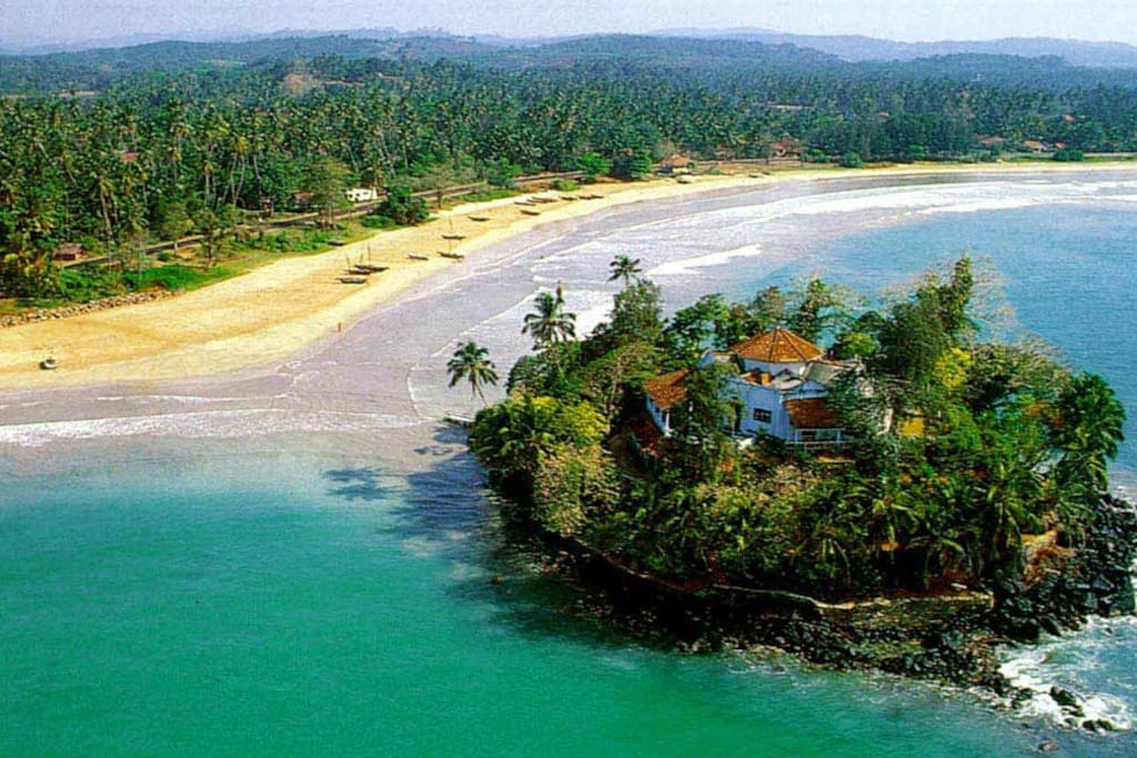 The Beach,100m behind our home ! Its Taprobane Island  !