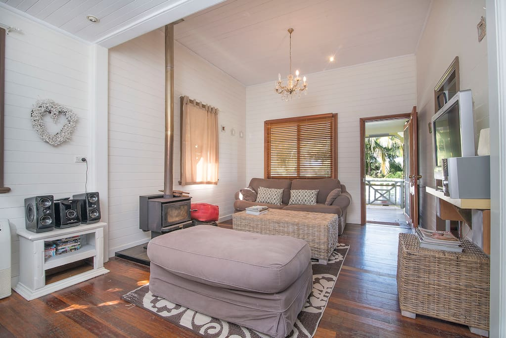Living room in main House of Bungalow 3, luxe soft furnishings, movies, book library to relax with.