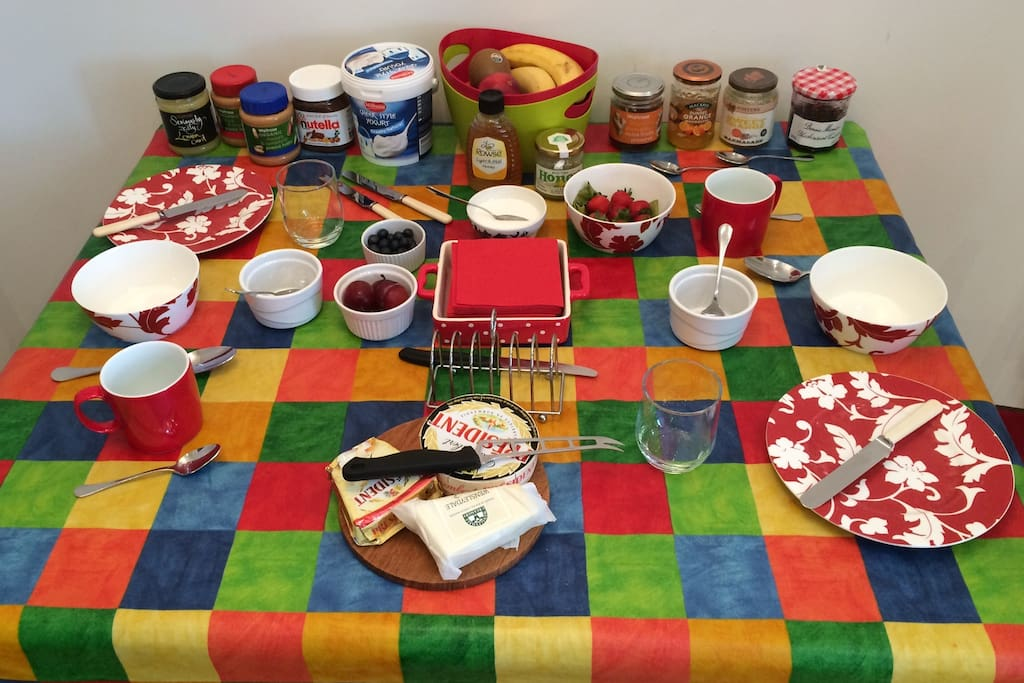 A typical self-serve breakfast: tea, coffee, home-made bread, cheese, spreads, fruit, yoghurt and cereal