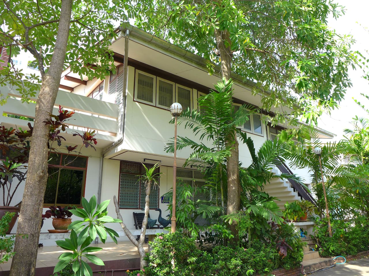 An original Hua Hin beach home nested in a lush garden. Only steps away from the beach.