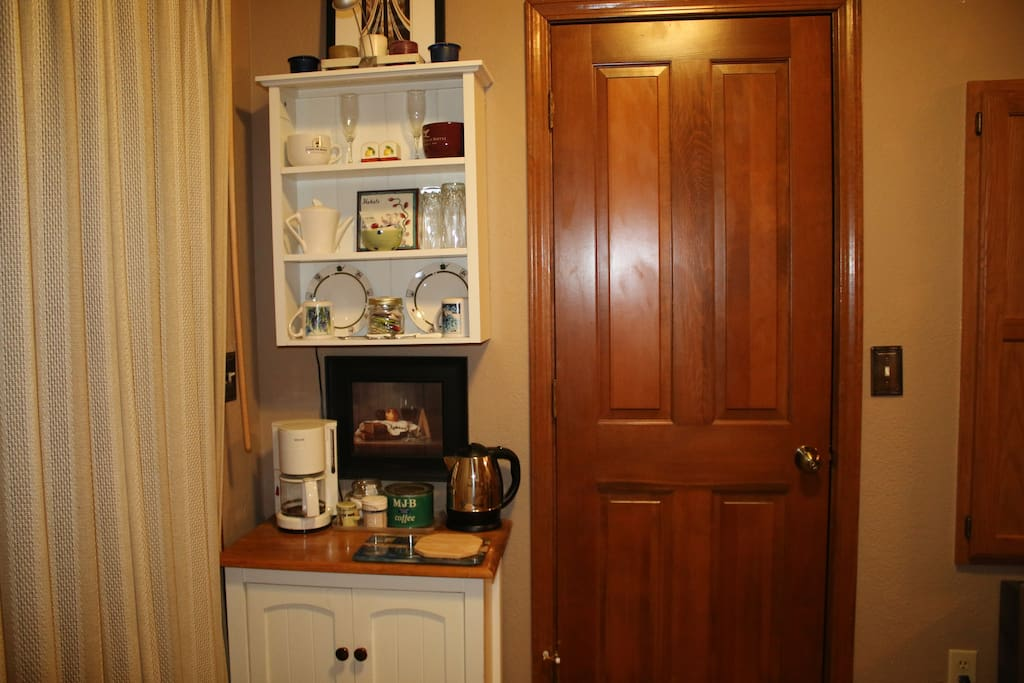 Your room also has a beverage bar with a coffee maker and tea kettle.  The cabinet has plates, glasses, flatwear, and a blender.