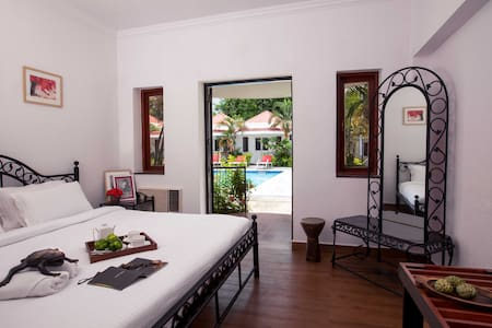 Private cottage rooms at Boutique Hotel Vagator - Bed & Breakfast